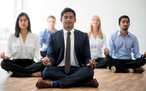 East Indian Business Meditating